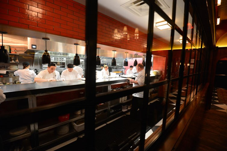Interior of The Avenue kitchen with kitchen staff
