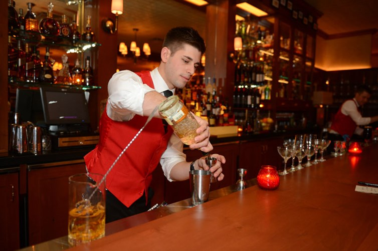 A bartender making a cocktail