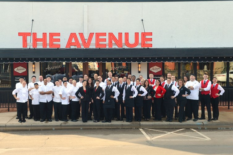 Exterior of The Avenue Grandview with staff out front.