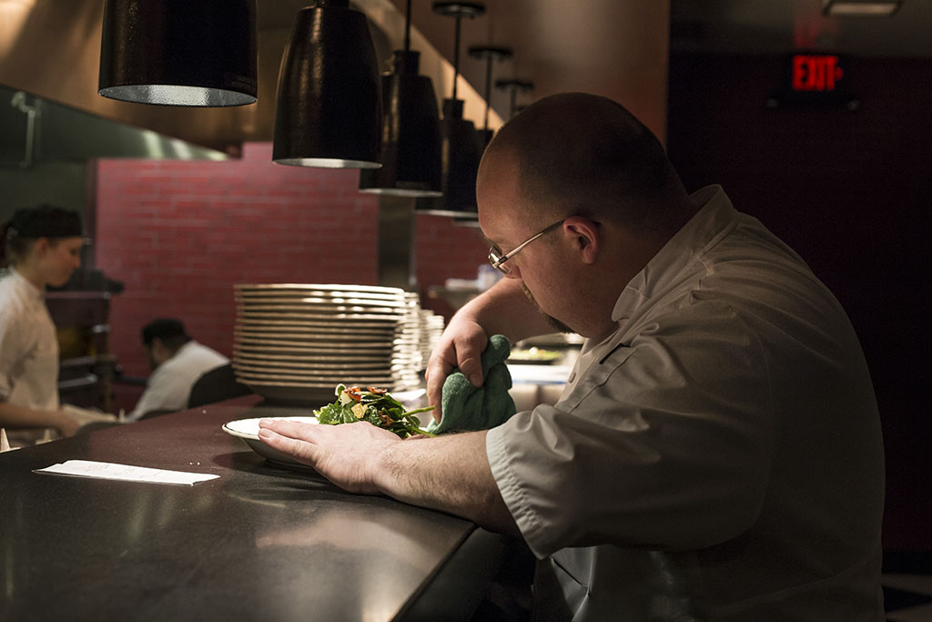 Chef Jeff Lindemeyer plating a meal
