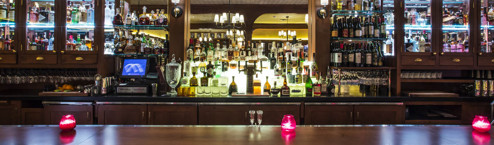 bottles of alcohol displayed behind the bar