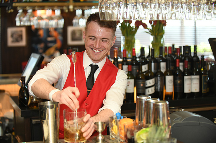 A bartender making a drink